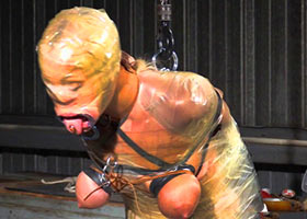Suspension of bound and mummified slave girl